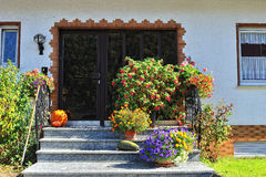 Flowers in front of the house entrance Royalty Free Stock Photography