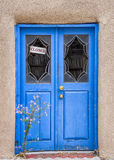 Flowers in Front of a Santa Fe Gallery Door Stock Photo