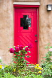 Flowers in Front of a Santa Fe Gallery Door Royalty Free Stock Image