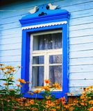 Flowers in front of the window of the old house. Summer landscape. Flowers in front of window of the old house. Summer landscape Stock Images