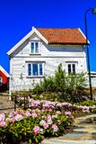Flowers in front of a wooden white house, Norway Royalty Free Stock Photo