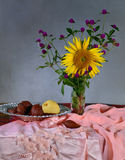 Flowers and fruit in still life concept Stock Image