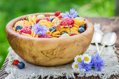 Flowers and fruits with cornflakes for breakfast Stock Photos