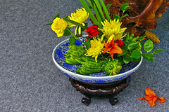 Flowers and fruits in porcelain pot Stock Photo