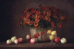 Flowers and fruits. Still life with flowers and fruit on the table Royalty Free Stock Photos