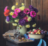 Flowers and fruits. Summer still life with flowers and fruit Royalty Free Stock Images