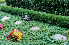 Flowers after a funeral in an old cemetery. In Germany stock photos