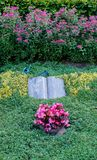 Flowers after a funeral in an old cemetery. In Germany royalty free stock photo