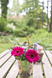 Flowers on a garden table Royalty Free Stock Images