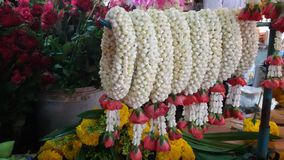 Flowers garland at fresh market Thailand Stock Photos