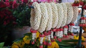 Flowers garland at fresh market Thailand Stock Photos