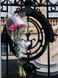 Flowers at Russian Consulate Embassy mourning of victims of fire. Flowers on the gate of Russian Consulate Embassy mourning of victims of fire at Zimnyaya Stock Photo