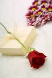 Flowers and gift Royalty Free Stock Image