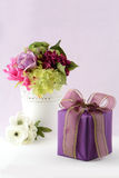 Flowers and gift Royalty Free Stock Photography