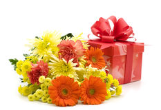 Flowers and gift box Stock Photography