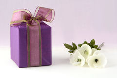 Flowers and gift box Stock Photos