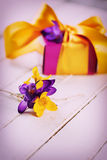 Flowers and gift box Stock Images