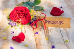 Gift card, voucher or coupon for Massage with flowers for Mothers or Valentines Day. Flowers with gift card, voucher or coupon for Massage stock photo