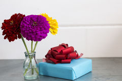 Flowers and gift. Close up royalty free stock image