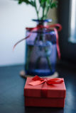 Flowers and gift Stock Photography