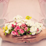 Flowers Gift in Woman Hands. Floral Background Royalty Free Stock Images
