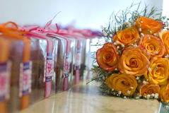 Flowers and gifts. On the table Royalty Free Stock Photo