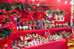 Flowers and gifts at Christmas market Royalty Free Stock Photos