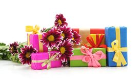 Flowers with gifts. On a white background stock photo