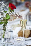 Flowers and glass of champagne Royalty Free Stock Photography
