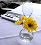 Flowers and glass on table Royalty Free Stock Image