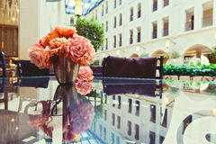 Flowers on glass table with reflection Stock Photography