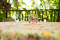 Flowers in a glass on the table Stock Photography