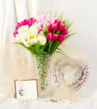 flowers in a glass vase with bann Royalty Free Stock Photos