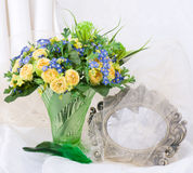 Flowers in a glass vase and frame Stock Photography