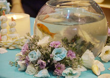 Flowers and gold fish. Photo with the image of bouquet and aquarium with a gold fish Royalty Free Stock Photography