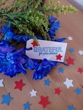 Flowers with Grateful for your service tag, Military, Thank you message stock photography