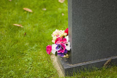 Flowers on grave. In a churchyard Stock Photo
