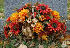 Flowers on a Grave. Fall flowers adorn a grave in late October stock photography