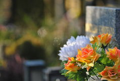 Flowers on a grave. Cemetery flowers close up photo Stock Photo