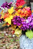 Flowers In A Graveyard. Vibrant flowers in a graveyard at dusk Stock Image