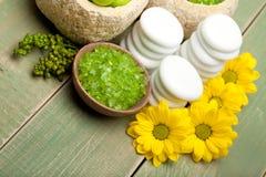 Flowers and green bath salt Stock Photography
