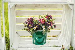 Flowers in a green bucket Royalty Free Stock Photography