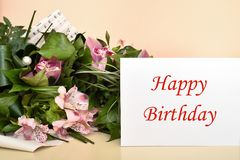 Flowers and greeting card with Happy Birthday message stock photos