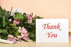 Flowers and greeting card with Thank You message stock photo