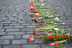 Flowers of grief on the Ukrainian streets Royalty Free Stock Image