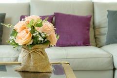 Flowers in gunnysack vase in living room Royalty Free Stock Photos