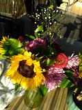 Flowers from the guy. Shadows on the flowers, arranged in a green vase Stock Photo