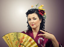 Flowers haired kimono woman doing cool hand gesture Stock Images