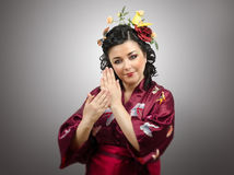 Flowers haired kimono woman showing traditional gestures Stock Photos