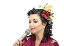 Flowers haired kimono woman singing karaoke Royalty Free Stock Photo
